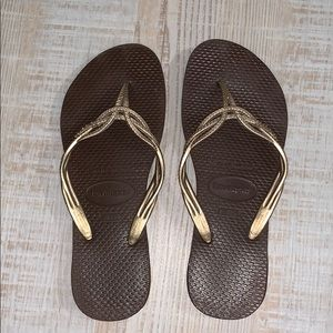 Brown rubber flip flops
